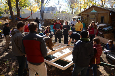 Participants at Tiny House workshop building