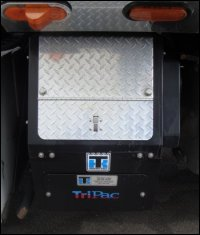 An auxiliary power unit or APU installed on a large truck.