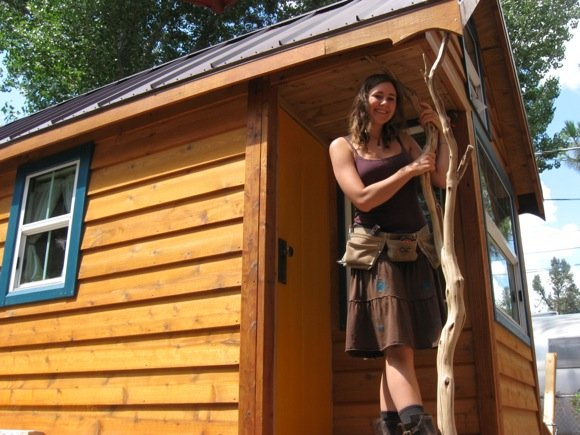 Ella in front of her Tiny Home